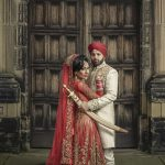 muslim wedding couple in front of wooden door